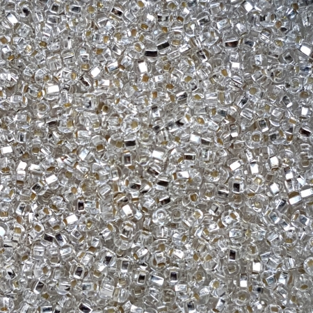 Margele nisip Preciosa Ornela 8/0 - 40 g - Transparent cu miez argintiu 78102